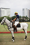 A man prepares for a polo match at the Manila Polo Club.