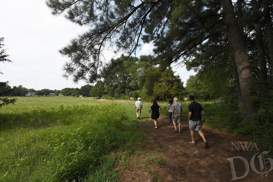 NWA Democrat-Gazette/J.T. WAMPLER Members of the Fayetteville Parks and Recreation Advisory Board take a tour of a piece of land adjacent to Gulley Park Monday August 5, 2019. The land is part of a proposed subdivision development. If accepted, the land would expand Gulley Park by about an acre.