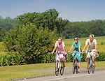 Teenage mennonite women riding bicycles to Mifflinburg, PA.