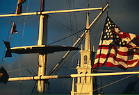 USA, Newport, RI - Nautical/maritime signal flags with the American flag flying fro the Bowen's wharf flag mast frame Newport's Trinity Church..