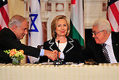 "United States Secretary of State Hillary Rodham Clinton, center, smiles as Prime Minister Benjamin Netanyahu of Israel, left, and Mahmoud Abbas of the Paqlestinian Authority shake hands following their remarks at the start of the ""Relaunch of Direct Negotiations Between the Israelis and Palestinians"" in the Benjamin Franklin Room of the U.S. Department of State on Thursday, September 2, 2010.  .Credit: Ron Sachs / CNP.(RESTRICTION: NO New York or New Jersey Newspapers or newspapers within a 75 mile radius of New York City)"