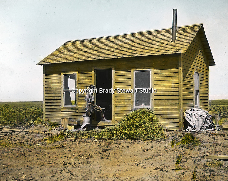 Jerome ID:  Brady Stewart repairing the farmhouse on the 160 acre estate - 1909.  Brady Stewart and three friends went to Idaho on a lark from 1909 thru early 1912.  As part of the Mondell Homestead Act, they received a grant of 160 acres north of the Snake River.  Brady Stewart photographed the adventures of farming along with the spectacular landscapes. To give family and friends a better feel for the adventure, he hand-color black and white negatives into full-color 3x4 lantern slides.  The Process:  He contacted a negative with another negative to create a positive slide.  He then selected a fine brush and colors and meticulously created full color slides.