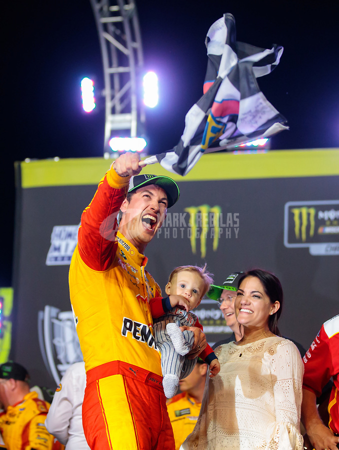 Nov 18, 2018; Homestead, FL, USA; NASCAR Cup Series driver Joey Logano (22) celebrates winning the Ford EcoBoost 400 and the NASCAR Cup Series championship at Homestead-Miami Speedway. Mandatory Credit: Mark J. Rebilas-USA TODAY Sports