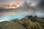 Waves crashing on the tilted strata rocks at Montana De Oro State Park near Morro Bay, California, USA.