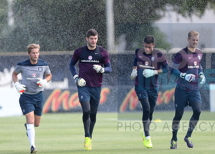 England's Fraser Forster, Ben Foster and Joe Hart run through the sprinkler during training<br /> <br /> England Training &amp; Press Conference  - Barry University - Miami - USA - 06/06/2014  - Pic David Klein/Sportimage