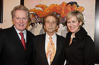 Jean Charest, Quebec Premier (L)<br />  J C de Vilallonga (M), <br /> Michele Dionne (R)<br /> <br /> Internationally  know artist J C de Vilallonga donated recent painting for a benefit sales for tyhose with menyal disabilities, held at Parisian laundry in <br /> Montreal, canada<br /> <br /> photo : (c) 2005 Images Distribution