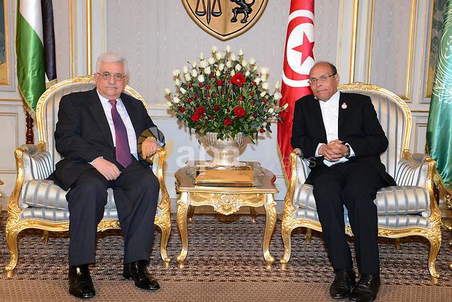 Palestinian President Mahmoud Abbas (Abu Mazen) meets with Tunisian President, Marzouki in Tunisia, on Jan. 14, 2013. Photo by Thaer Ganaim