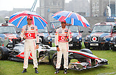 "© licensed to London News Pictures. London, UK  07/07/2011. In the lead up to the 2011 British Grand Prix at Silverstone, Forumula 1 world champions Jenson Button and Lewis Hamilton posed during a torrential downpour with ""Union Jack"" London Cabs and a Vodafone McLaren Mercedes F1 car. Please see special instructions for usage rates. Photo credit should read Bettina Strenske/LNP"