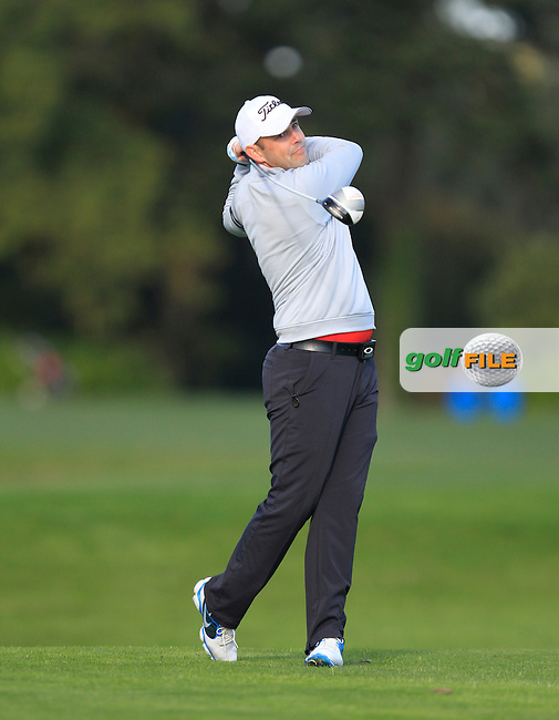 Ryan Donagher (Knock G.C) on the 13th tee during Round 1 of The Cassidy Golf 103rd Irish PGA Championship in Roganstown Golf Club on Thursday 10th October 2013.<br /> Picture:  Thos Caffrey / www.golffile.ie