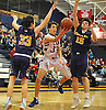 John Munyak #33 of Cold Spring Harbor, center, tries to get to the net as Oyster Bay's Luke Puccio #33, left, and Anthony Reilly #15 guard him during a Nassau County varsity boys basketball game at Cold Spring Harbor High School on Monday, Jan. 16, 2017. Cold Spring Harbor won by a score of 72-45.