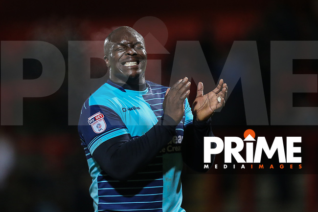 Adebayo Akinfenwa of Wycombe Wanderers applaud the travelling fans after the Sky Bet League 2 match between Stevenage and Wycombe Wanderers at the Lamex Stadium, Stevenage, England on 9 December 2017. Photo by David Horn.