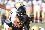 Beverly Hills, CA 09/23/11 - unknown Beverly Hills player(s) and Andrew Phillips (Peninsula #11) in action during the Peninsula-Beverly Hills frosh football game at Beverly Hills High School.