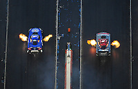 Jan. 21, 2012; Jupiter, FL, USA: Aerial view of NHRA funny car driver Robert Hight (left) races alongside Cruz Pedregon during testing at the PRO Winter Warmup at Palm Beach International Raceway. Mandatory Credit: Mark J. Rebilas-