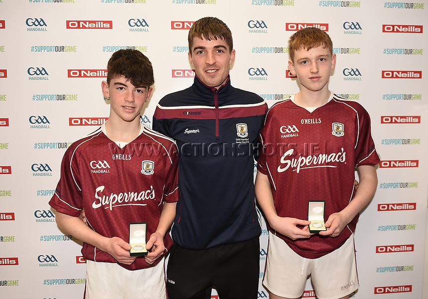 19/03/2018; 40x20 All Ireland Juvenile Championships Finals 2018; Kingscourt, Co Cavan;<br /> Boys Under-15 Doubles; Galway (Paul Kearns/Darragh Kyne) v Cork (Kealan Murphy/Gearoid Healy)<br /> Runners-up Paul Kearns and Darragh Kyne with Martin Mulkerrins<br /> Photo Credit: actionshots.ie/Tommy Grealy