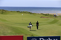 Thomas Detry (BEL) and caddy Ryan walk onto the 6th green during Thursday's Round 1 of the Dubai Duty Free Irish Open 2019, held at Lahinch Golf Club, Lahinch, Ireland. 4th July 2019.<br /> Picture: Eoin Clarke | Golffile<br /> <br /> <br /> All photos usage must carry mandatory copyright credit (© Golffile | Eoin Clarke)