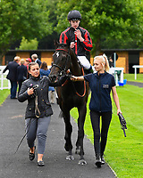 Winner of Peter Symonds Catering Handicap (Class 5),  Field of Vision ridden by Oisin Murphy and trained by Joeseph Tuite is led into the winners emclosure during Afternoon Racing at Salisbury Racecourse on 7th August 2017