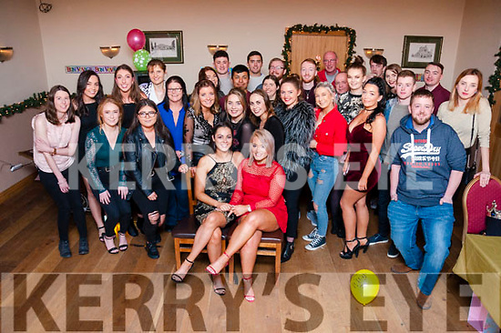 Jenny Plunkett and Tara O'Sullivan (center) pictured with friends and family at their going away party on Saturday night at Kerins O'Rahilly's GAA Club. The girls are heading down under to Australia for a year.