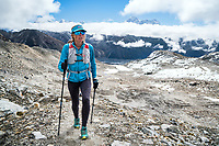 Trail running on Renjo La Pass, the last pass, while doing the whole 3 Passes Tour, Khumbu Valley, Nepal.