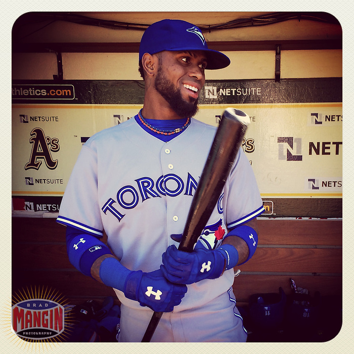 OAKLAND, CA - JULY 3: Instagram of Jose Reyes of the Toronto Blue Jays getting ready in the dugout before a game against the Oakland Athletics at O.co Coliseum on July 3, 2014 in Oakland, California. Photo by Brad Mangin