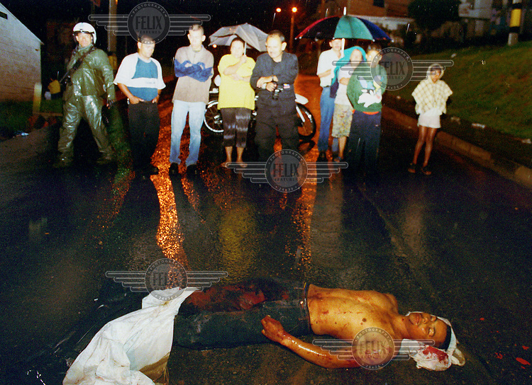 ©Paul Smith/Panos Pictures..COLOMBIA: MedellÌn..A homicide victim (Chelenin), shot eleven times by assailants in a car, who then sped off.