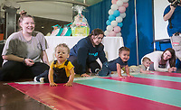 NWA Democrat-Gazette/BEN GOFF @NWABENGOFF<br /> Mothers encourage their babies to crawl in a heat of the 'Diaper Races' Saturday, March 10, 2018, during the Power 105.7 Worlds Largest Baby Shower at the Jones Center in Springdale. The event sponsored by Washington Regional, with proceeds from ticket sales going to March of Dimes, included a variety of vendors, activities and seminars to help new and expecting parents provide the best care for their babies.