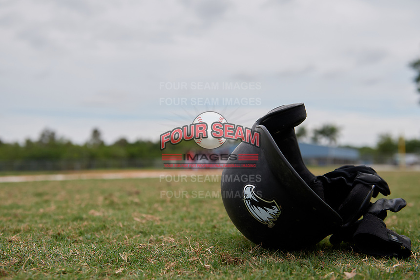 An Edgewood Eagles helmet rest on the ground after a game against the Babson Beavers on March 18, 2019 at Lee County Player Development Complex in Fort Myers, Florida.  Babson defeated Edgewood 23-7.  (Mike Janes/Four Seam Images)