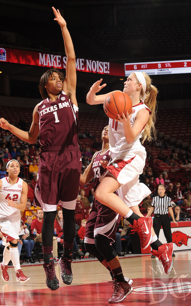 NWA Media/ANDY SHUPE - Arkansas' Calli Berna, right, reaches to score over Texas A&M's Courtney Williams (1) during the second half of the Razorbacks' 52-50 loss Sunday, Jan. 4, 2015, in Bud Walton Arena in Fayetteville.