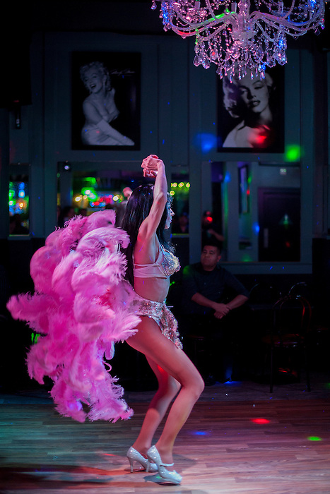 Melanie Machetto dances in front of namesake pictures of Marilyn Monroe at Franco's Norma Jean's Nightclub in Castroville, Calif. on December 18, 2015.