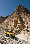 A yellow jeep with the Motherlode Rock Crawlers travels down a rock-piled road in the Argus Range of California.