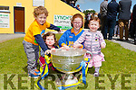 First cousins Sean O'Donoghue, Sophie Nolan, Laura and Maeve O'Donoghue who got their picture taken with the Sam Maguire Cup at the opening of the Cordal GAA pitch on Sunday.