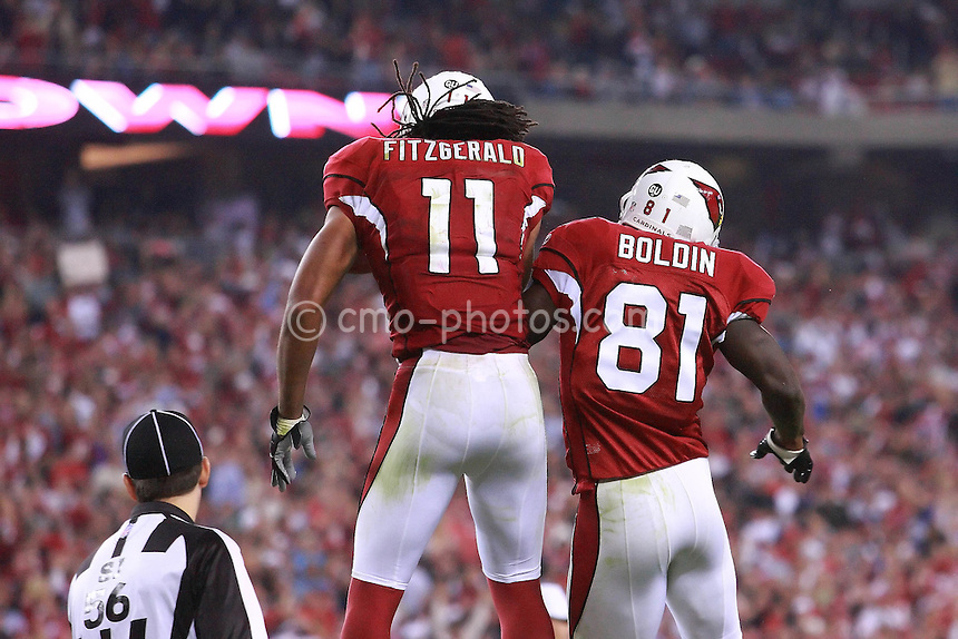 Nov 10, 2008; Glendale, AZ, USA; Arizona Cardinals wide receiver Larry Fitzgerald (11) and wide receiver Anquan Boldin (81) jump into the air to celebrate a third quarter touchdown by Fitzgerald during a Monday Night Football game against the San Francisco 49ers at University of Phoenix Stadium.  The Cardinals won the game 29-24.