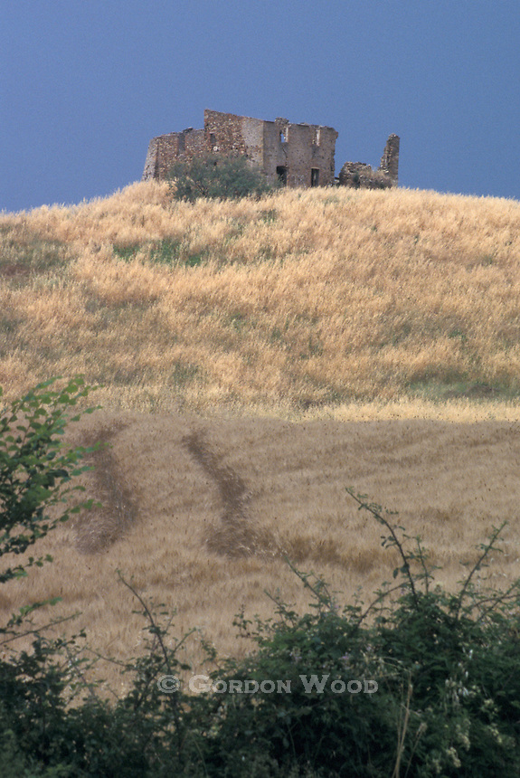 Abandoned House on Hilltop in Wheat Field, Tuscany, Italy
