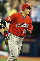 March 7, 2009:  Designated Hitter Joey Votto (19) of Canada smiles on his way back to the dugout after hitting a home run during the first round of the World Baseball Classic at the Rogers Centre in Toronto, Ontario, Canada.  Team USA defeated Canada 6-5 in both teams opening game of the tournament.  Photo by:  Mike Janes/Four Seam Images