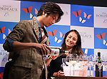 """April 19, 2018, Tokyo, Japan - Japanese actor Mokomichi Hayami pours Bordeaux wine for tasting at a promotional event of French Bordeaux wines in Tokyo on Thursday, April 19, 2018. Bordeaux wine bureau C.I.V.B. will have a three-day event """"My Bordeaux Party"""" to provide 100 selected brands Bordeaux wines with 300yen for a glass at a pop-up bar from April 20.  (Photo by Yoshio Tsunoda/AFLO) LWX -ytd-"""