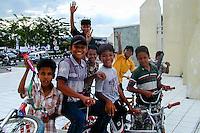 Indonesia, Sumatra. Medan. Kids doing acrobatics on a street in Medan center.