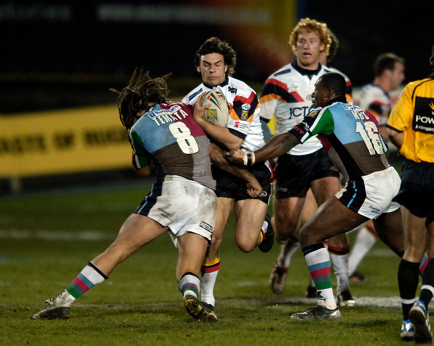 Photo: Jed Wee..Bradford Bulls v Harlequins RL. Engage Super League. 18/02/2006..Bradford's Matt Cook (2nd, L) gets caught up in the Quins defence.