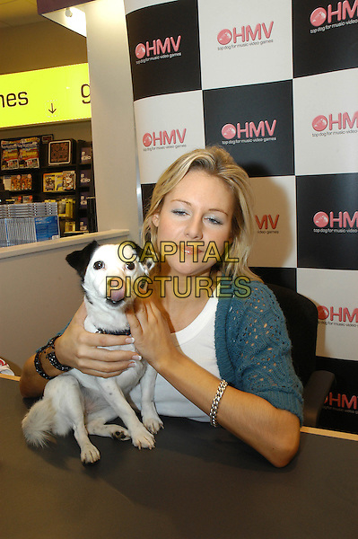 ABI TITMUSS.Opening HMV in Chesterfield.November 25th, 2004.half length, puppy, dog, animal, pet, tongue.www.capitalpictures.com.sales@capitalpictures.com.©Capital Pictures