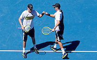 MIKE BRYAN & BOB BRYAN (USA) against ROSS HUTCHINS & COLIN FLEMING (GBR) in the third round of the Men's Doubles. Mike & Bob Bryan beat Ross Hutchins & Colin Fleming 6-4 0-6 6-2..22/01/2012, 22nd January 2012, 22.01.2012 - Day 7..The Australian Open, Melbourne Park, Melbourne,Victoria, Australia.@AMN IMAGES, Frey, Advantage Media Network, 30, Cleveland Street, London, W1T 4JD .Tel - +44 208 947 0100..email - mfrey@advantagemedianet.com..www.amnimages.photoshelter.com.