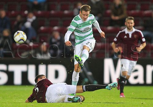 30.11.2014.  Edinburgh, Scotland. Scottish Cup.  Hearts versus Celtic. Alim Ozturk slides in on Stefan Johansen as he clears