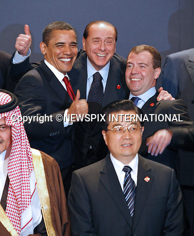"G20 WORLD LEADERS.United States President Barack Obama, Prime Minister of Italy Silvio Berlusconi and President of the Russian Federation Dmitry Medvedev pose for the Heads of Delegation Family photograph before the start of the G20 Summit, Excel Centre, London_02/04/2009.Photo: Newspix International..**ALL FEES PAYABLE TO: ""NEWSPIX INTERNATIONAL""**..PHOTO CREDIT MANDATORY!!: NEWSPIX INTERNATIONAL(Failure to credit will incur a surcharge of 100% of reproduction fees)..IMMEDIATE CONFIRMATION OF USAGE REQUIRED:.Newspix International, 31 Chinnery Hill, Bishop's Stortford, ENGLAND CM23 3PS.Tel:+441279 324672  ; Fax: +441279656877.Mobile:  0777568 1153.e-mail: info@newspixinternational.co.uk"