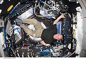 NASA astronaut Scott Kelly, Expedition 25 flight engineer, is pictured in the Cupola of the International Space Station on October 14, 2010. NASA has selected Kelly for a one-year mission aboard the station in 2015. Kelly will join Russian cosmonaut Mikhail Kornienko on a mission that will collect scientific data important to future human exploration of our solar system. The goal of the yearlong expedition aboard the orbiting laboratory is to understand better how the human body reacts and adapts to the harsh environment of space. Data from the 12-month expedition will help inform current assessments of crew performance and health and will determine better and validate countermeasures to reduce the risks associated with future exploration as NASA plans for missions around the moon, an asteroid and ultimately Mars..Credit: NASA via CNP
