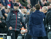 27th October 2019; Anfield, Liverpool, Merseyside, England; English Premier League Football, Liverpool versus Tottenham Hotspur; Liverpool manager Jurgen Klopp walks over to shake hands with Tottenham Hotspur manager Mauricio Pochettino as the match ends in a Liverpool 2-1 win - Strictly Editorial Use Only. No use with unauthorized audio, video, data, fixture lists, club/league logos or 'live' services. Online in-match use limited to 120 images, no video emulation. No use in betting, games or single club/league/player publications