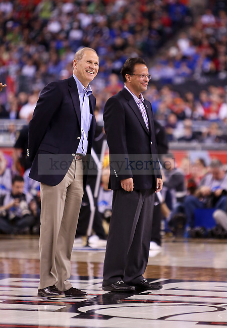 Michigan head coach John Beilein  was honored during a timeout of during the game between the Kentucky wildcats and the Wisconsin Badgers in the Final Four of the 2015 NCAA Men's Basketball Tournament at Lucas Oil Stadium on Saturday, April 4, 2015 in Indianapolis, In.  Photo by Jonathan Krueger | Staff.