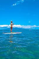 Young woman standup paddle boarding, Maui
