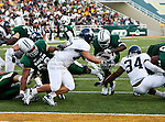 Rice Owls defensive lineman Brian Stacey (69) and Baylor Bears running back Terrance Ganaway (24) in action during the game between the Rice Owls and the Baylor Bears at the Floyd Casey Stadium in Waco, Texas. Baylor defeats Rice 56 to 31.