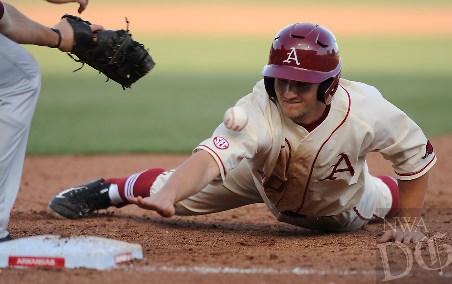 NWA Democrat-Gazette/ANDY SHUPE - Joe Serrano of Arkansas heads back to first as first baseman Tanner Donnels of Loyola Marymount misplays the throw from the mound during the sixth inning Saturday, March 7, 2015, at Baum Stadium in Fayetteville.