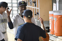 Starting pitcher Tony Dibrell (8) of the Columbia Fireflies is congratulated during a game against the Charleston RiverDogs in which he set a Fireflies single-season strikeout record of 138 on Tuesday, August 28, 2018, at Spirit Communications Park in Columbia, South Carolina. Columbia won, 11-2. (Tom Priddy/Four Seam Images)