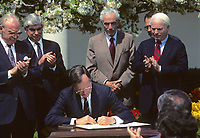 Washington DC., USA, April1, 1989<br /> President  George H.W. Bush signs budget agreement in Rose Garden ceremony with members of the congressional leadership looking on. Credit: Mark Reinstein/MediaPunch
