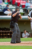 Home plate umpire Sean Barber makes a strike call during the International League between the Indianapolis Indians and the Charlotte Knights at Knights Stadium on July 22, 2012 in Fort Mill, South Carolina.  The Indians defeated the Knights 17-1.  (Brian Westerholt/Four Seam Images)