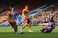 Darren Randolph slides out to gather the ball watched by Steven Hammell and Shaun Hutchinson